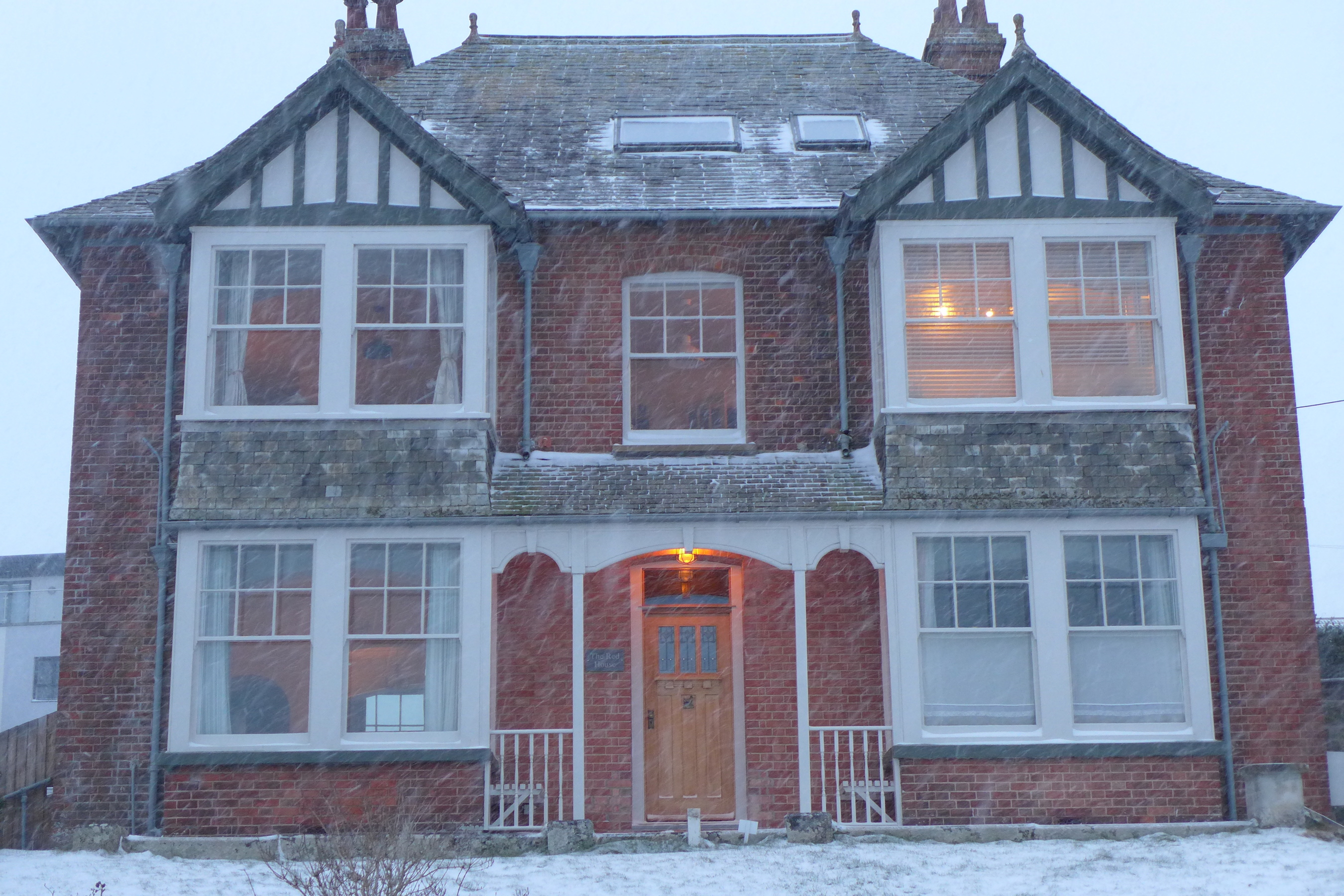 The Red House wrapped in Emma and The Beast from The East